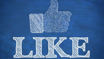 Thumb up representing social network logo above the word like written on blue background