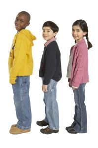 Girl and two boys (7-9) standing side by side, side view, portrait