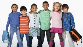 Multi-ethnic children hugging
