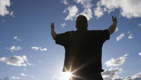Man raising arms toward the sky