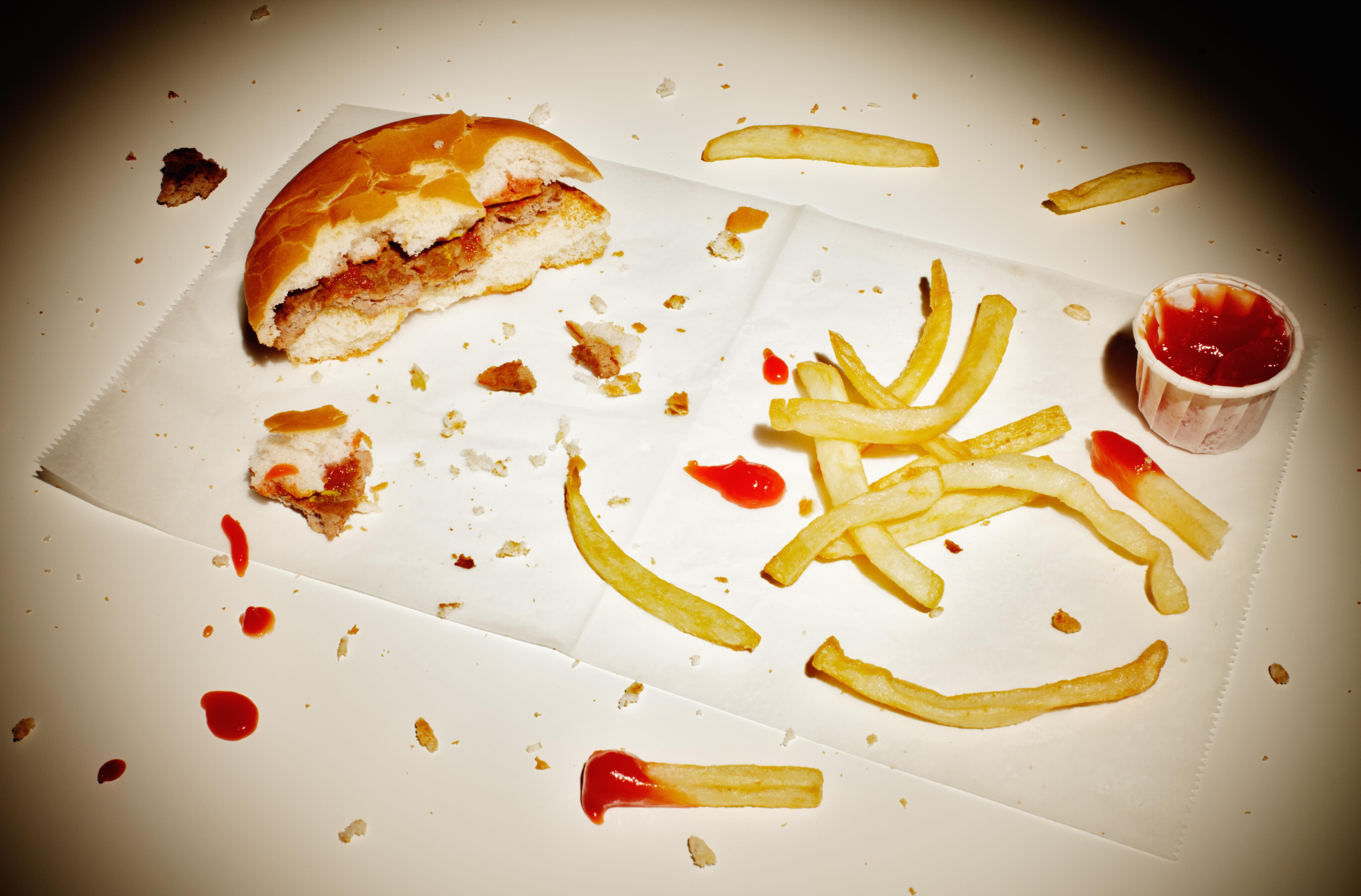 Half eaten burger and fries.