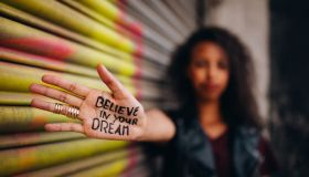 African American girl with inspirational meassage written on her hand