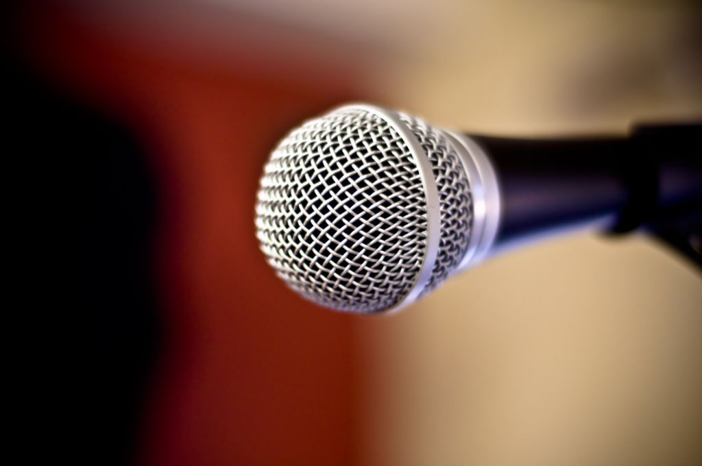 Close up of metal microphone against defocused background