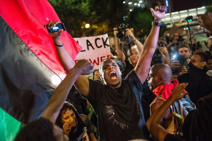 Protesters React To Death Of Keith Lamont Before State Of Emergency in Charlotte is Declared