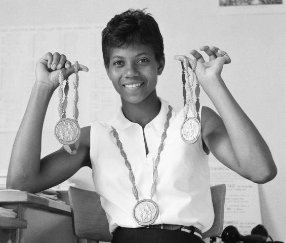Wilma Rudolph Holding Her Gold Medals