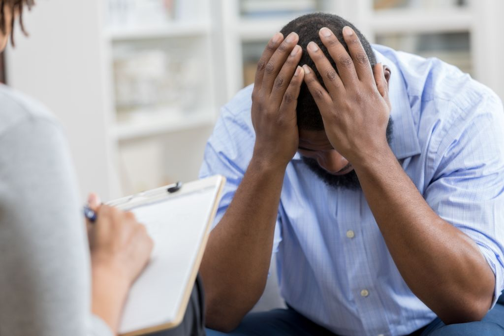 Upset man with mental health professional