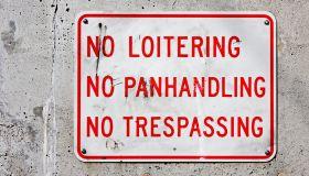 No Loitering, No Panhandling, No Trespassing Sign