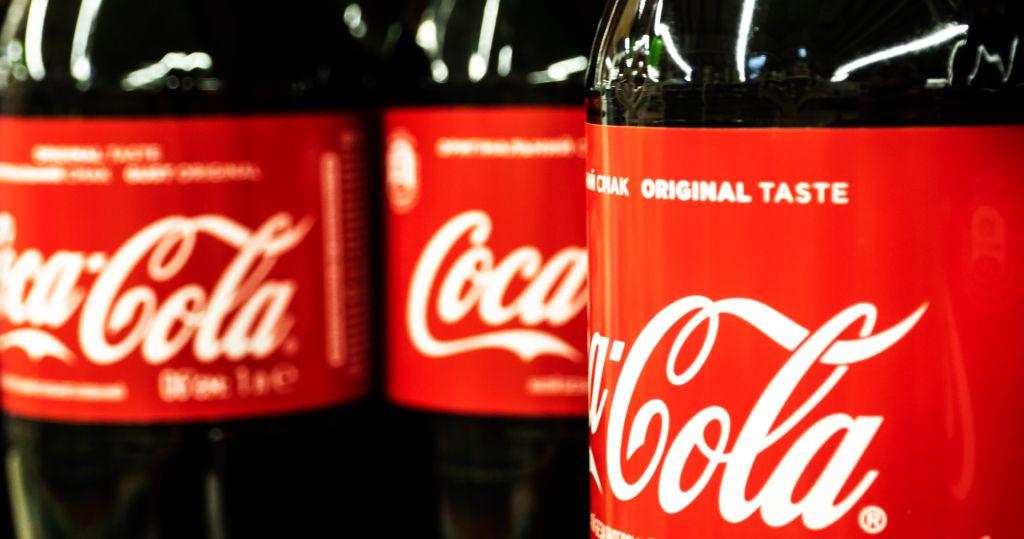 Row of Coca Cola bottles seen in store...