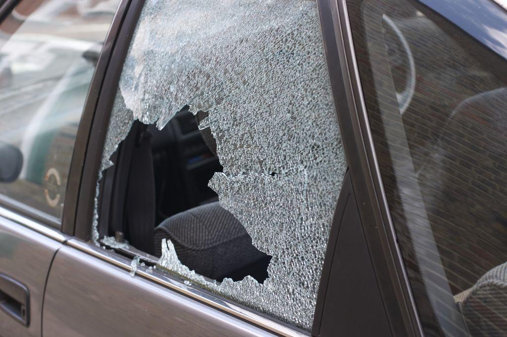 Thief broken glass in car window
