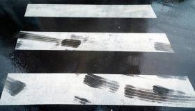 tire tracks in dangerous zebra crossing