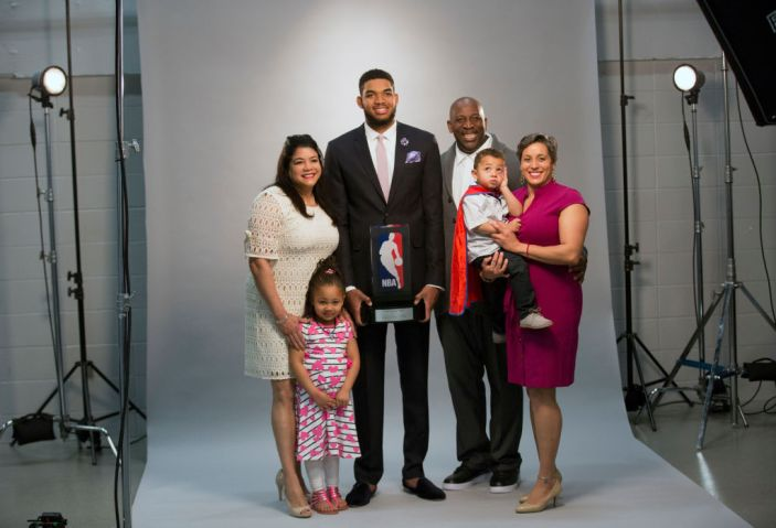 Timberwolves player Karl Anthony Towns with his family before being named rookie of the year,