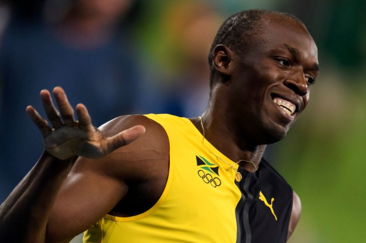 Usain Bolt of Jamaica reacts at the end of the men's 100m...
