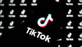 In this photo illustration a TikTok logo is seen displayed...