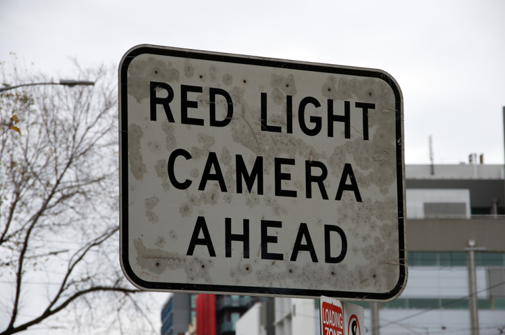 'Red light camera' traffic warning sign