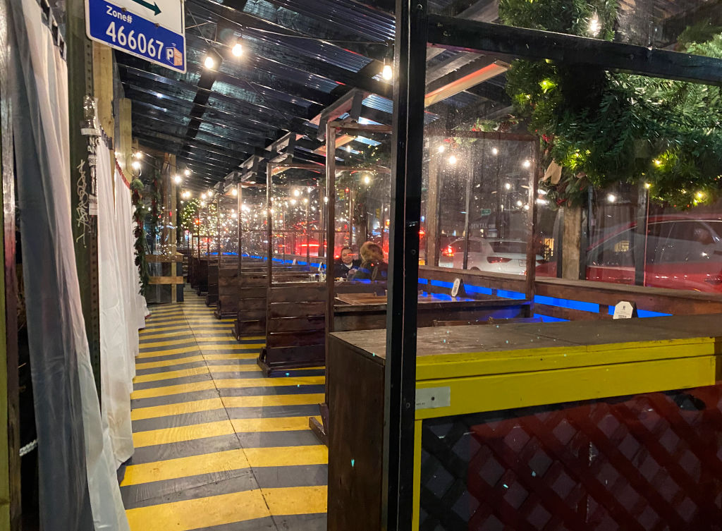Restaurant outdoor dining shelters on winter's night, Queens, New York