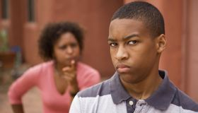 Upset teen and mother outside of house